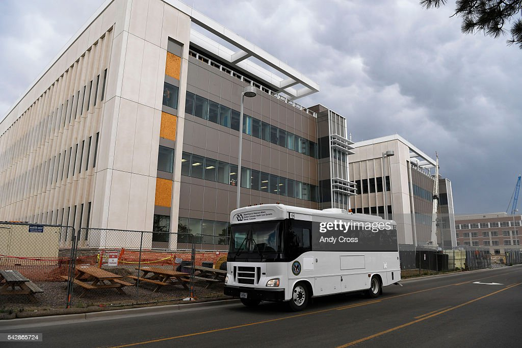 A Department of Veterans Affairs bus drives past the new VA Hospital under construction June 24, 2016.