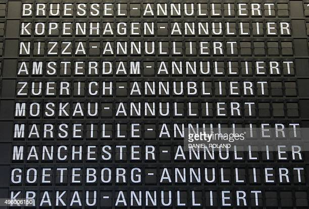 A departure board displays cancelled flights operated by German airline Lufthansa at the airport in Frankfurt am Main on November 6 2015 as the...