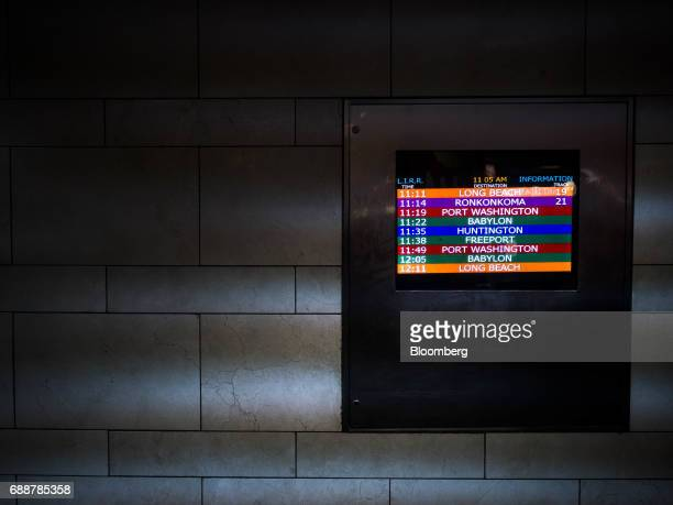 A departure board is displayed on a wall at the Long Island Railroad Co concourse inside Pennsylvania Station in New York US on Friday May 26 2017...