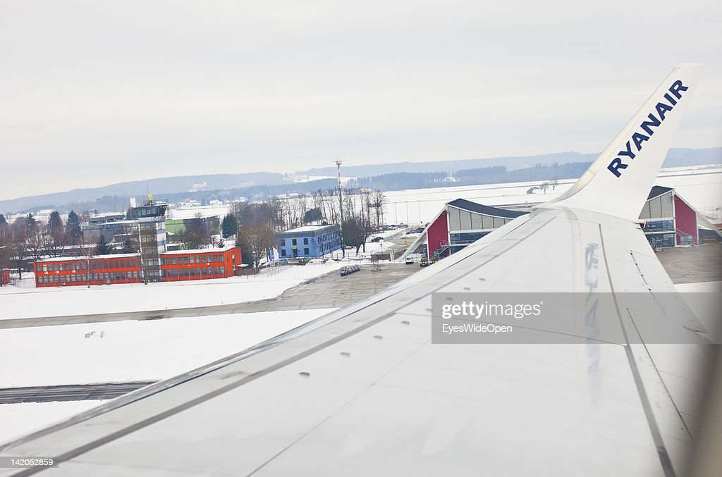Departure of a RyanAir flight to Alicante, Spain in winter times at Allgaeu Airport on February 18, 2012 in Memmingen, Germany.