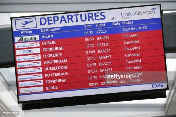 A departure screen at London City Airport in London shows cancelled flights after protestors blocked the runway of the airport on September 6 2016 /...