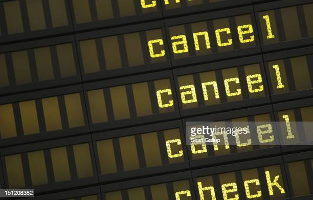 A departures board shows cancellations after Lufthansa flights were cancelled during a strike by Lufthansa cabin crew at Tegel Airport on September 4...