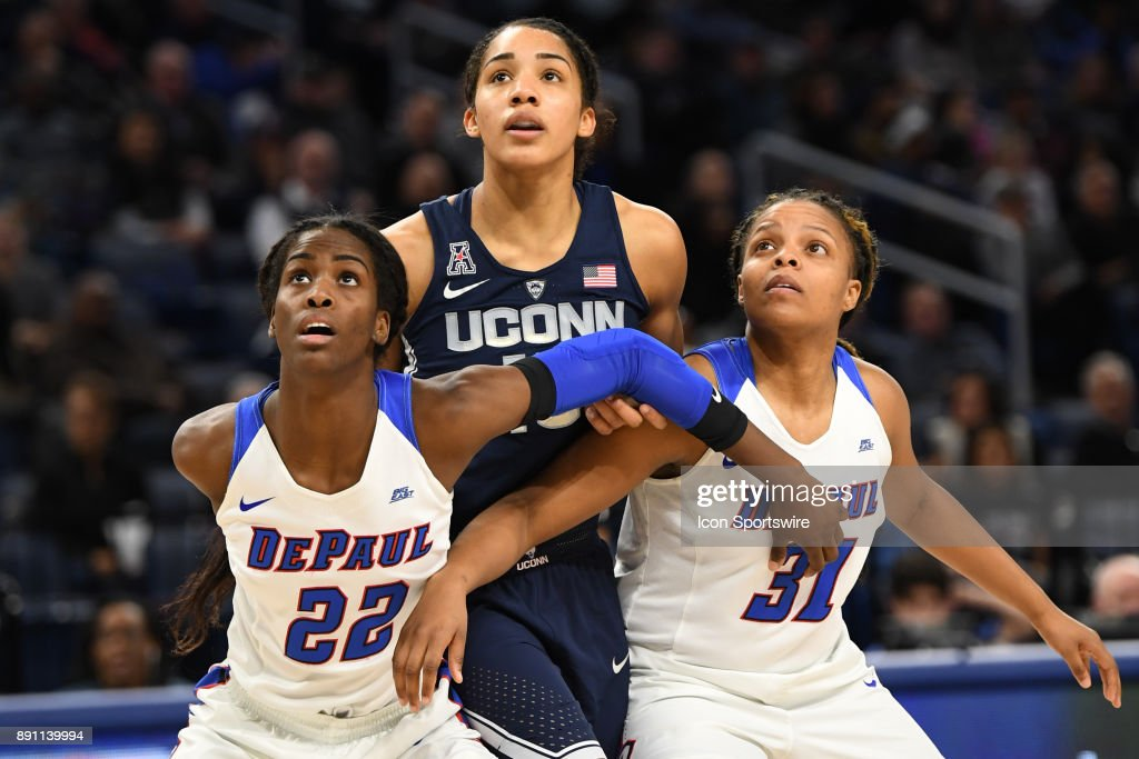 DePaul Blue Demons forward Chante Stonewall (22) and DePaul Blue Demons guard Deja Cage (31) blocks Connecticut Huskies forward Gabby Williams (15) during a game between the Connecticut Huskies and the DePaul Blue Demons on December 8, 2017, at the Wintrust Arena in Chicago, IL. Connecticut won 101-69.