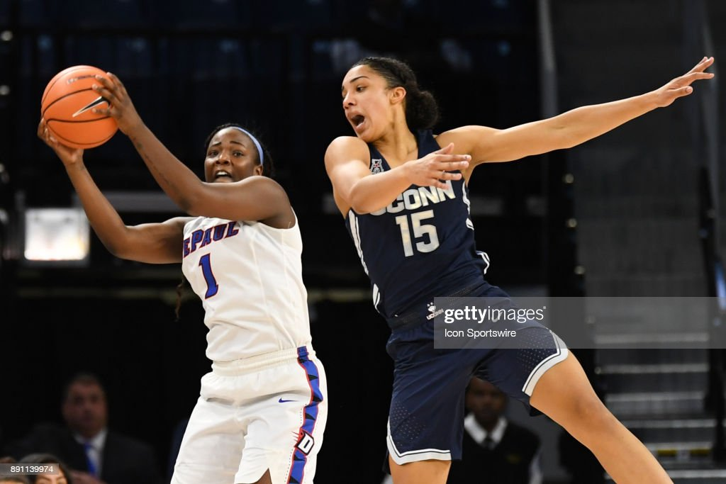 DePaul Blue Demons guard Ashton Millender (1) controls the ball against Connecticut Huskies forward Gabby Williams (15) during a game between the Connecticut Huskies and the DePaul Blue Demons on December 8, 2017, at the Wintrust Arena in Chicago, IL. Connecticut won 101-69.