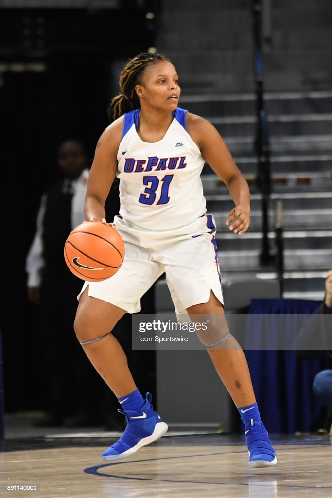 DePaul Blue Demons guard Deja Cage (31) controls the ball during a game between the Connecticut Huskies and the DePaul Blue Demons on December 8, 2017, at the Wintrust Arena in Chicago, IL. Connecticut won 101-69.