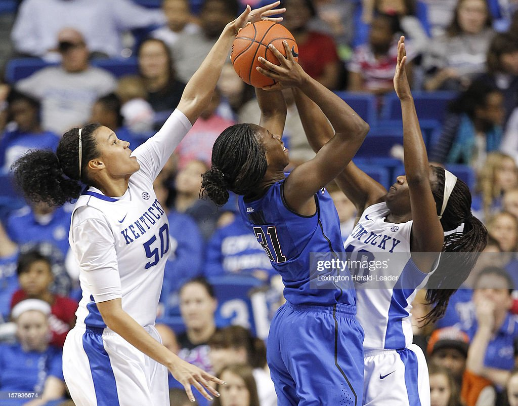 DePaul Blue Demons guard Jasmine Penny (31) gets blocked by Kentucky Wildcats forward Azia Bishop (50) and Kentucky forward Brittany Henderson (40) during game action at Rupp Arena in Lexington, Kentucky, Friday, December 7, 2012. Kentucky defeated DePaul, 96-64.