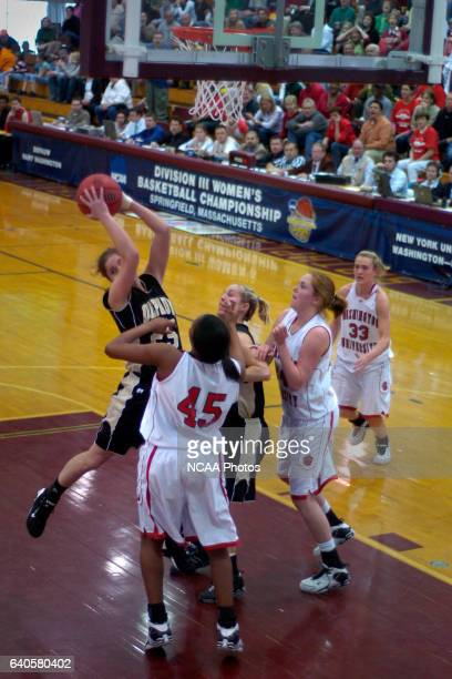 DePauw's Gwen Haehl grabs a rebound against Washington University during the Division III Women's Basketball Championship held at Blake Arena on the...