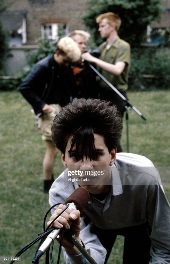 Depeche Mode pose with microphones circa 1981 Dave Gahan is at the front behind are Martin Gore Vince Clark Andrew Fletcher