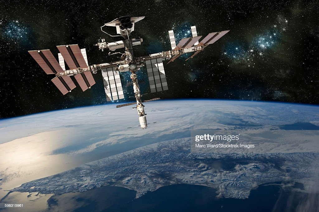 A depiction of the space shuttle docked at the International Space Station orbiting Earth.