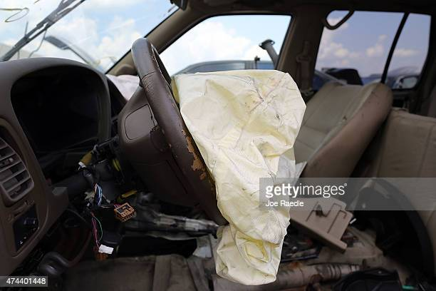 A deployed airbag is seen in a Nissan vehicle at the LKQ Pick Your Part salvage yard on May 22 2015 in Medley Florida The largest automotive recall...