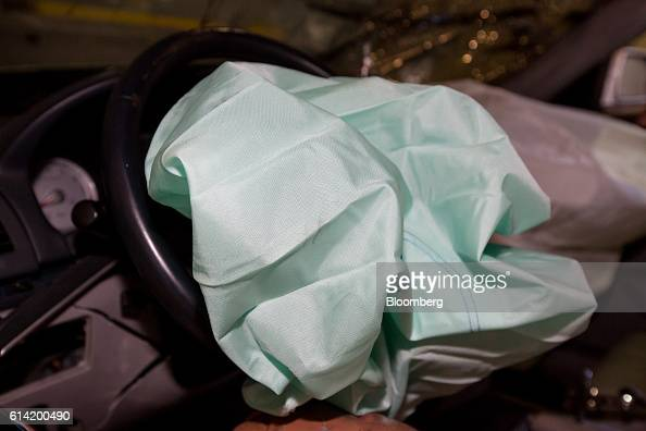 A deployed airbag is seen inside a damaged Hyundai Motor Co NF Sonata automobile following a crash test at the Korea Automobile Insurance Repair...