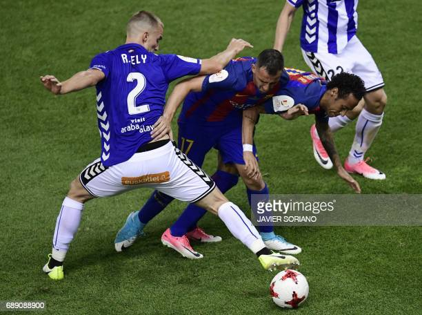 Deportivo Alaves' Brazilian defender Rodrigo Ely vies with Barcelona's Brazilian forward Neymar and Barcelona's forward Paco Alcacer during the...