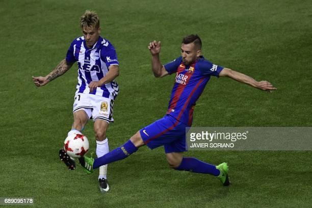 Deportivo Alaves' defender Kiko Femenia vies with Barcelona's defender Jordi Alba during the Spanish Copa del Rey final football match FC Barcelona...