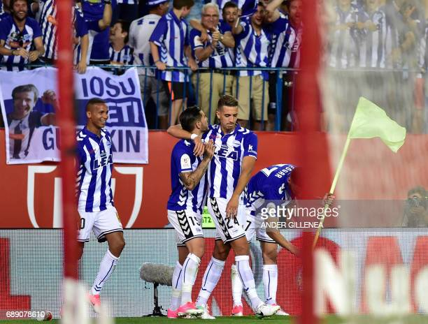 Deportivo Alaves' French defender Theo Hernandez celebrates with Deportivo Alaves' Moroccan defender Zouhair Feddal after scoring the equalizer...