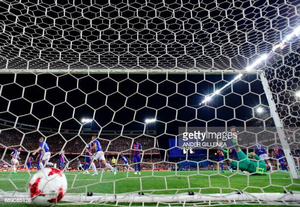 Deportivo Alaves' French defender Theo Hernandez scores the equalizer during the Spanish Copa del Rey final football match FC Barcelona vs Deportivo...