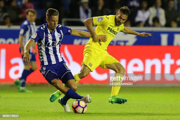 Deportivo Alaves midfielder Marcos Llorente vies with Villarreal's defender Mario Gaspar Perez Martinez during the Spanish league football match...