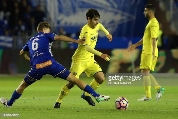 Deportivo Alaves midfielder Marcos Llorente vies with Villarreal's defender Jaume Costa during the Spanish league football match Deportivo Alaves vs...