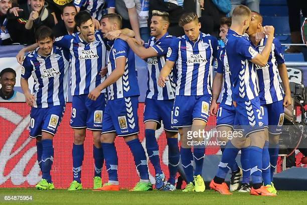 Deportivo Alaves players celebrate a goal during the Spanish league football match Deportivo Alaves vs Real Sociedad at the Mendizorroza stadium in...