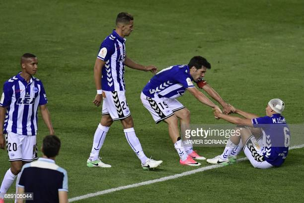 Deportivo Alaves players react after being defeated by Barcelona at the end of the Spanish Copa del Rey final football match FC Barcelona vs...