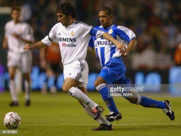 Deportivo Coruna Brazilian Djalma Feitosa 'Djalminha' vies with Real Madrid's Raul Gonzalez in a Liga match in Coruna 01 May 2004