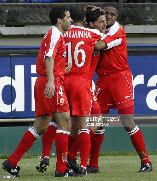 Deportivo Coruna's Diego Tristan celebrates his goal against Villarreal with teammate Nourredine Naybet of Morocco Brazilian Djalminha and...