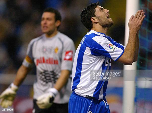Deportivo Coruna's forward Diego Tristan raises his hands after missing a scoring opportunity next to Real Zaragoza's goalkeeper Cesar Lainez during...