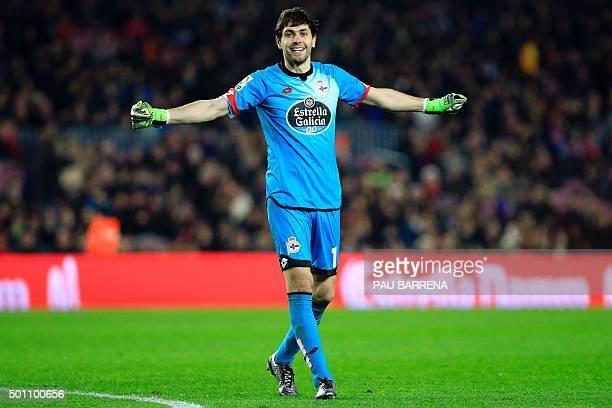 Deportivo de La Coruna's Argentinian goalkeeper German Lux smiles as he celebrates Deportivo La Coruna's midfielder Alex's goal during the Spanish...