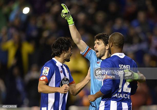Deportivo La Coruna's Argentinian goalkeeper German Dario Lux celebrate after stopping a penaltyshot during the Spanish league football match RC...