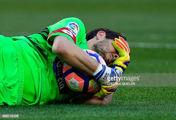 Deportivo La Coruna's Argentinian goalkeeper German Dario Lux lies on the field during the Spanish league football match Sevilla FC vs RC Deportivo...