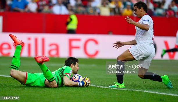 Deportivo La Coruna's Argentinian goalkeeper German Dario Lux secures the ball in front of Sevilla's French forward Wissam Ben Yedder during the...