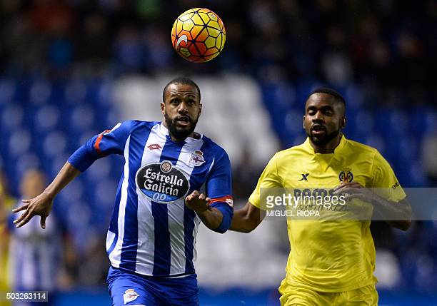 Deportivo La Coruna's Brazilian defender Sidnei vies with Villarreal's Congolese forward Cedric Bakambu during the Spanish league football match RC...