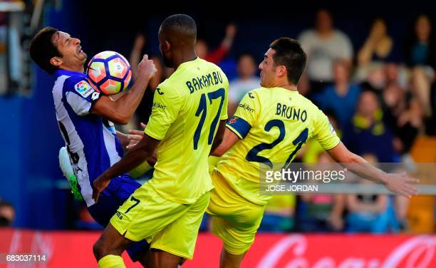 Deportivo La Coruna's Costa Rican midfielder Celso Borges vies with Villarreal's midfielder Bruno Soriano during the Spanish league football match...