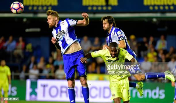 Deportivo La Coruna's defender Alejandro Arribas and Deportivo La Coruna's defender Raul Albentosa vie with Villarreal's Congolese forward Cedric...
