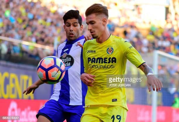 Deportivo La Coruna's defender Juanfran Moreno vies with Villarreal's midfielder Samuel Castillejo during the Spanish league football match...