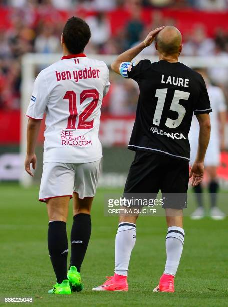 Deportivo La Coruna's defender Laure Sanabria stands after a goal by Sevilla's French forward Wissam Ben Yedder during the Spanish league football...