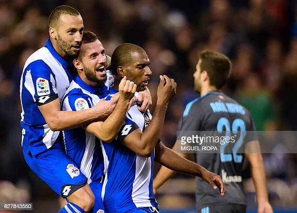 Deportivo La Coruna's Dutch forward Ryan Babel celebrates a goal with teammates Romanian forward Florin Andone and Turkish midfielder Emre Colak...