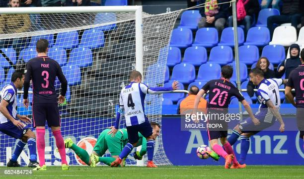 Deportivo La Coruna's forward Joselu kicks the ball to score the opening goal during the Spanish league football match RC Deportivo de la Coruna vs...