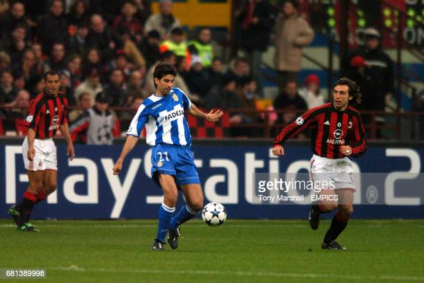 Deportivo La Coruna's Juan Valeron clears the ball under pressure from AC Milan's Andrea Pirlo