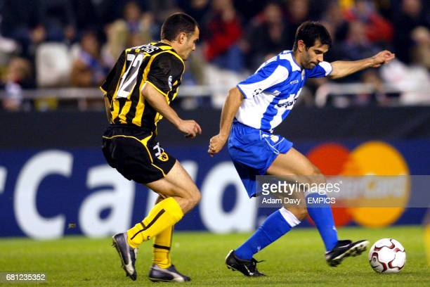 Deportivo La Coruna's Juan Valeron shields the ball from AEK Athens' Mihalis Kapsis