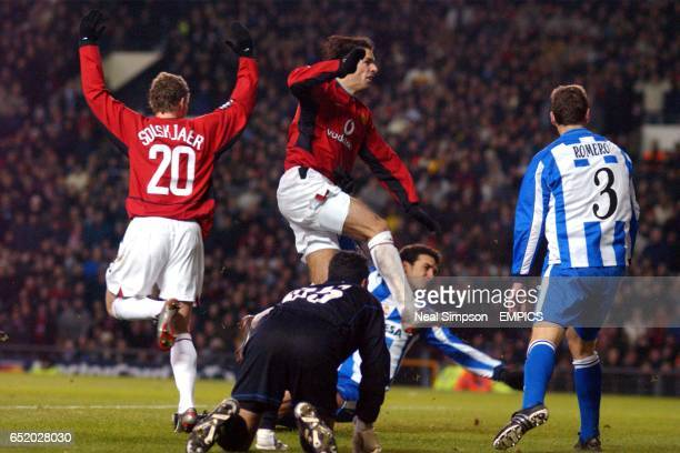 Deportivo La Coruna's Juanmi and Romero fail to stop Manchester United's Ruud Van Nistelrooy from scoring their second goal
