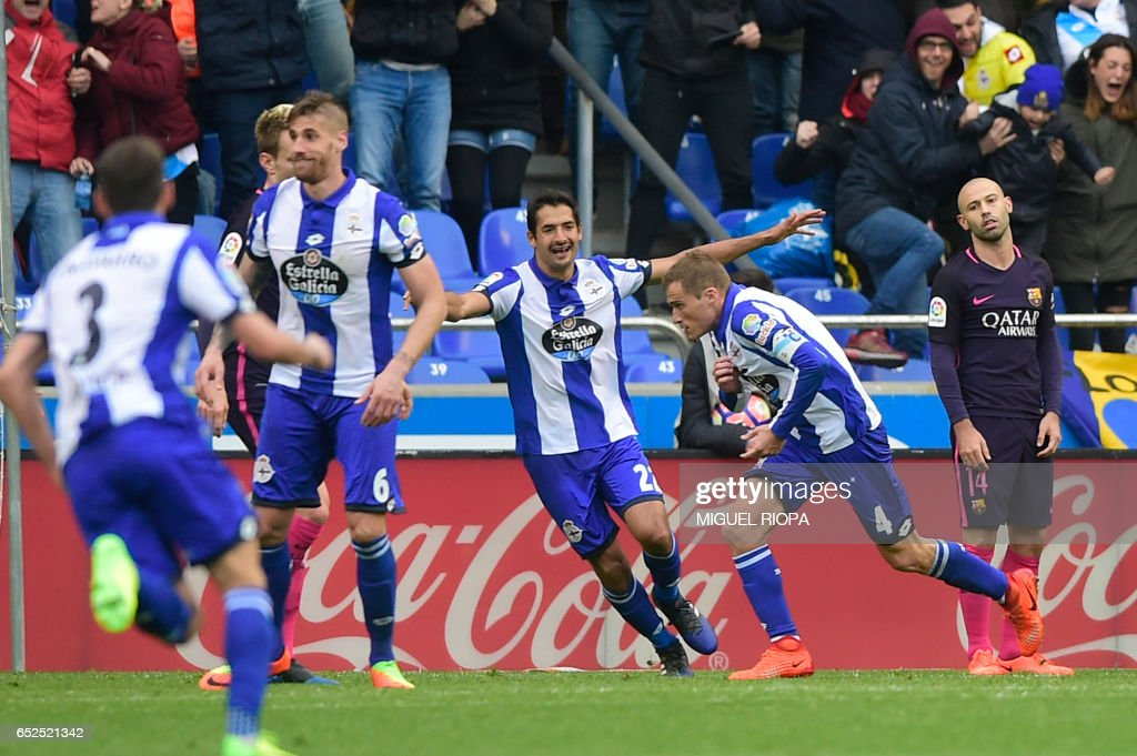 Deportivo La Coruna's midfielder Alex Bergantinos (2R) celebrates a goal during the Spanish league footbal match RC Deportivo de la Coruna vs FC Barcelona at the Municipal de Riazor stadium in La Coruna on March 12, 2017. /