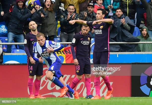 Deportivo La Coruna's midfielder Alex Bergantinos celebrates after scoring during the Spanish league football match RC Deportivo de la Coruna vs FC...