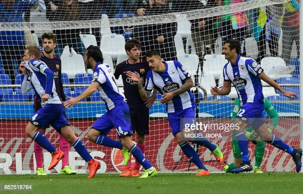 Deportivo La Coruna's midfielder Alex Bergantinos run with teammates as he celebrates a goal during the Spanish league footbal match RC Deportivo de...