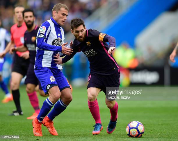 Deportivo La Coruna's midfielder Alex Bergantinos vies with Barcelona's Argentinian forward Lionel Messi during the Spanish league football match RC...