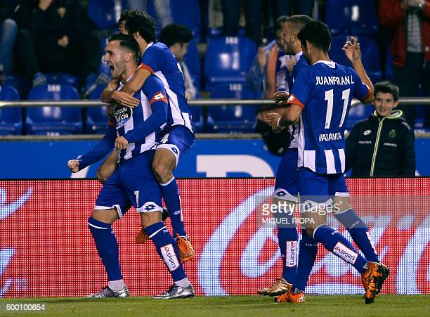 Deportivo La Coruna's midfielder Lucas Perez celebrates a goal with teammates during the Spanish league football match RC Deportivo de la Coruna vs...