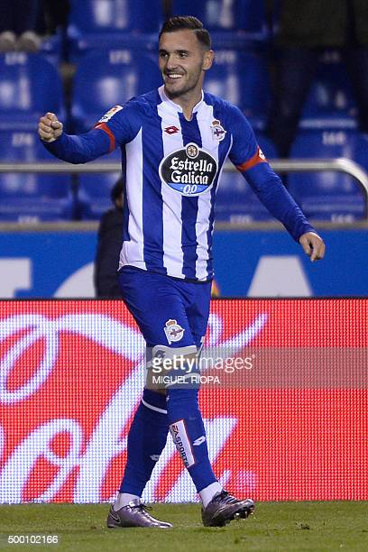 Deportivo La Coruna's midfielder Lucas Perez celebrates after scoring a goal during the Spanish league football match RC Deportivo de la Coruna vs...