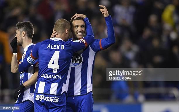 Deportivo La Coruna's midfielder Lucas Perez hugs his teammate midfielder Alex Bergantinos after scoring their second goal during the Spanish league...
