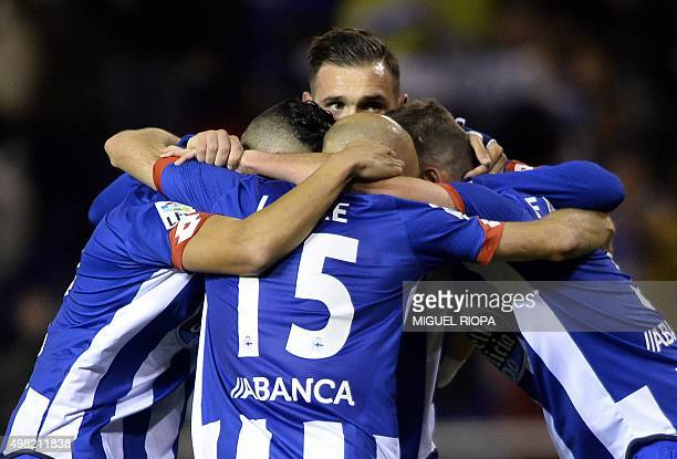 Deportivo La Coruna's midfielder Lucas Perez hugs teammates celebrating their second goal during the Spanish league football match RC Deportivo La...
