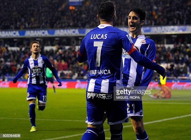 Deportivo La Coruna's midfielder Luis Alberto celebrates with a teammate after scoring a goal during the Spanish league football match RC Deportivo...