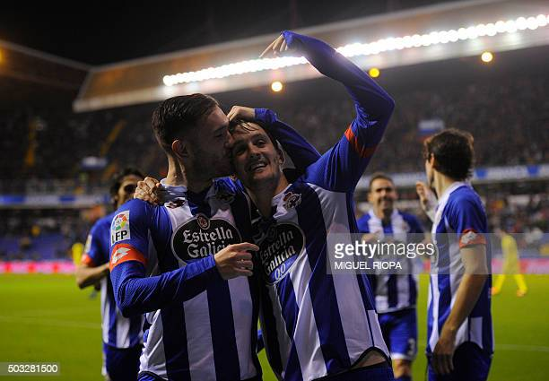 Deportivo La Coruna's midfielder Luis Alberto celebrates with teammate midfielder Lucas Perez after scoring a goal during the Spanish league football...